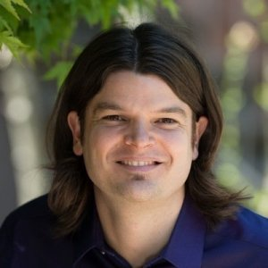 A headshot of book marketer Joel Pitney