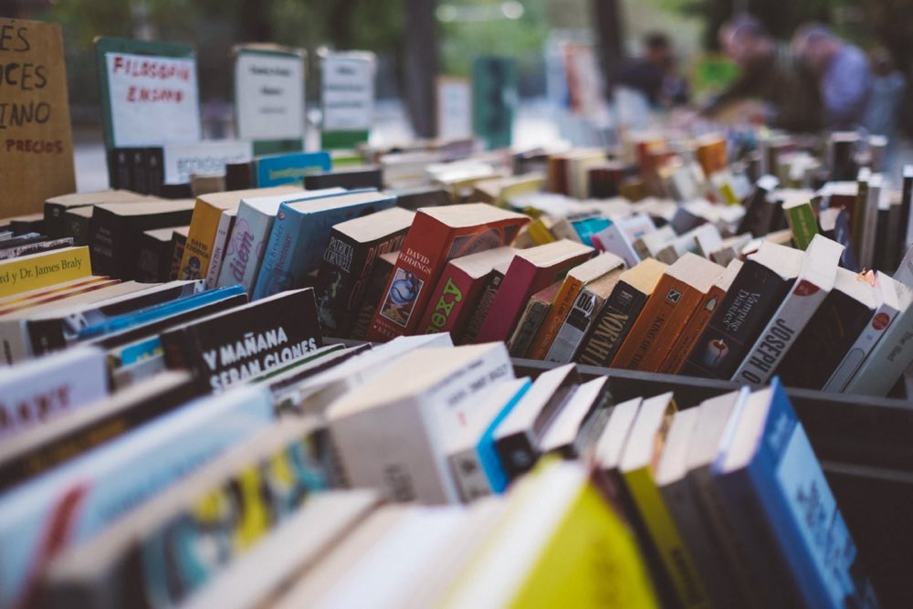how to be a good editor | books laid out in an outdoor market